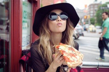 girl eating pizza
