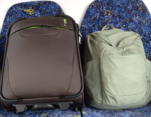 personal items for carry-on - A 25L carry-on suitcase with Pacsafe Slingsafe daypack as personal item.