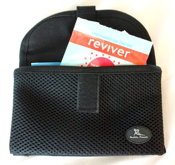 The Buddy Pouch holding a Reviver freshening wipe.