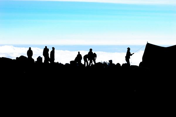 trekker silhouettes on Mount Kilimanjaro tour