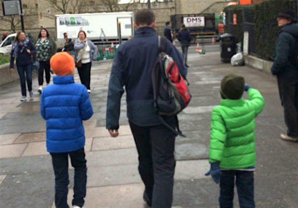 Husband & boys rugged up warm in London .